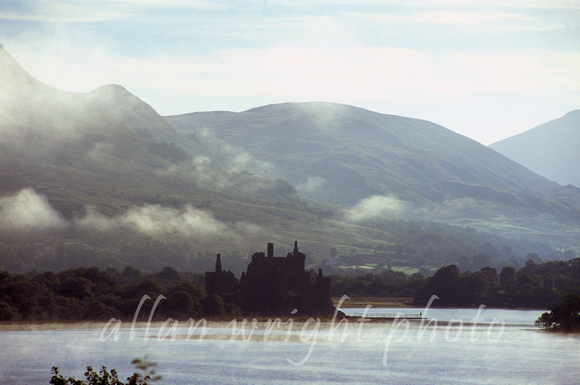 kilchurn castle with mist rising from loch awe